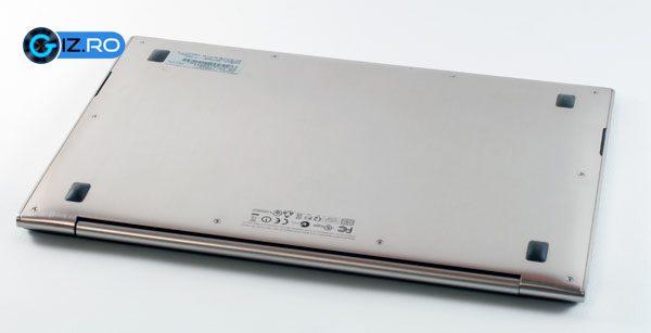 Spatele dintr-o bucata, nu permite accesul rapid la baterie sau la componentele interne